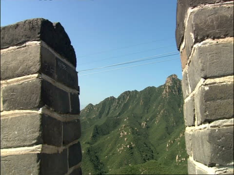 view from great wall of china battlements across to cable car and mountains, badaling, china - great wall of china stock videos & royalty-free footage