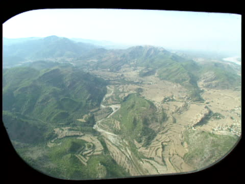 view from helicopter window as it flies over green mountains nowshera district pakistan - eskapismus stock-videos und b-roll-filmmaterial