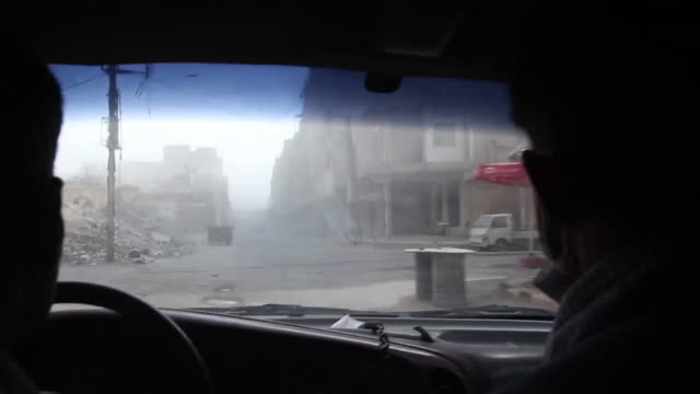 view from inside an ambulance in eastern ghouta syria as rescue teams respond to an air strike - syrien stock-videos und b-roll-filmmaterial