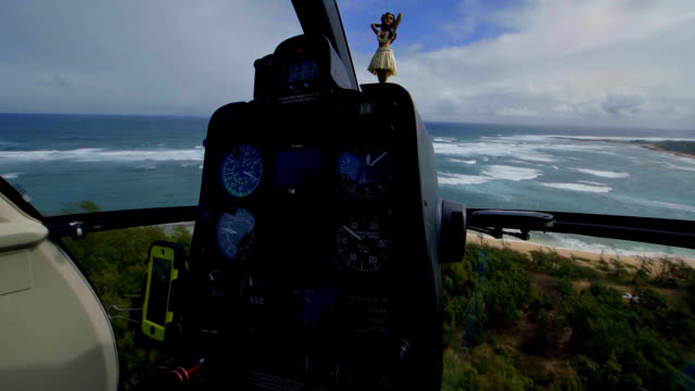 view from inside cockpit of a helicopter looking out over the coast of hawaii - turtle bay hawaii stock videos & royalty-free footage