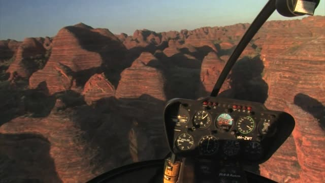 view from inside helicopter flying in the bungle bungle range, australia. - viewpoint stock videos & royalty-free footage