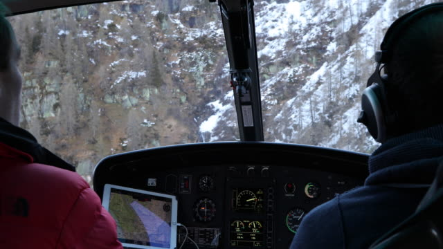 view from inside helicopter, while descending through mountains - helicopter tour stock videos and b-roll footage