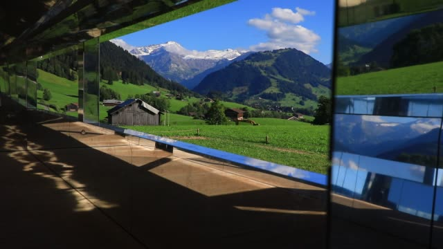 a view from inside mirage gstaad by los angelesbased artist doug aitken is on display outside as installation sculpture representing a chalet made... - ski resort stock videos & royalty-free footage