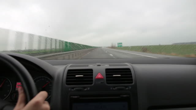 view from inside the car on a rainy day. - taxi driver stock videos and b-roll footage