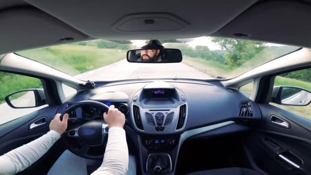 view from inside the car on the steering wheel and the road - accelerator pedal stock videos & royalty-free footage