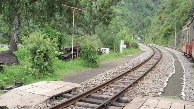 View from Kalka-Shimla toy train, coming to a halt at a station