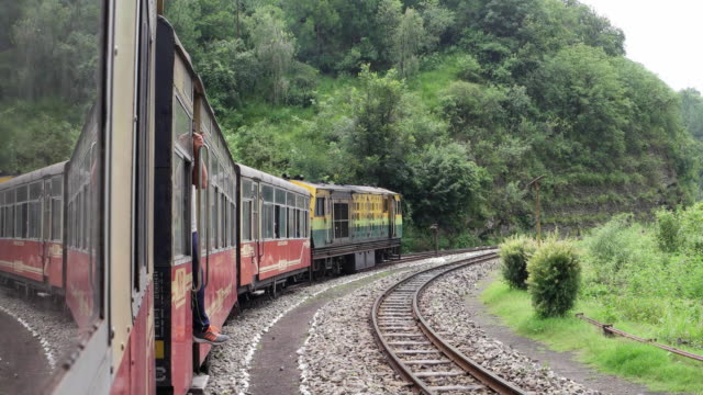 view from kalka-shimla toy train, waiting at a station while a person takes photos - british rail stock videos & royalty-free footage