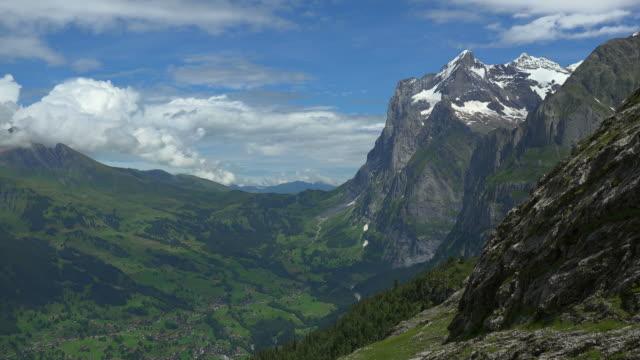 view from kleine scheidegg to wetterhorn and grindelwald, bernese alps, switzerland - bernese alps stock videos & royalty-free footage