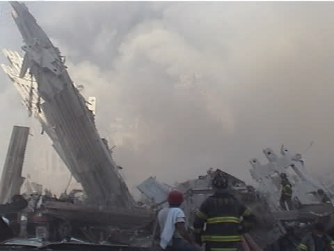 view from liberty st and west st. firemen walk over rubble, damaged fire truck, the world trade center building three in foreground, with the world... - september 11 2001 attacks stock videos & royalty-free footage