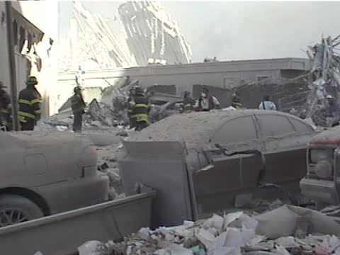 view from liberty st and west st. wreckage of the world trade center tower two, world financial center entrance, close up of burnt rubble during the... - september 11 2001 attacks点の映像素材/bロール