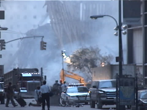 stockvideo's en b-roll-footage met view from liberty st. looking west, at the rubble of the world trade center during the late afternoon on september 13th, 2001 in new york city, usa.... - september 11 2001 attacks