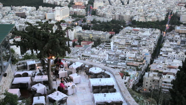 view from lykavittos hill overlooking a restaurant and the beautiful city of athens, greece, europe - lycabettus hill stock videos & royalty-free footage