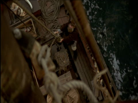 view from mast as viking moves around below on long ship norway - marinaio video stock e b–roll