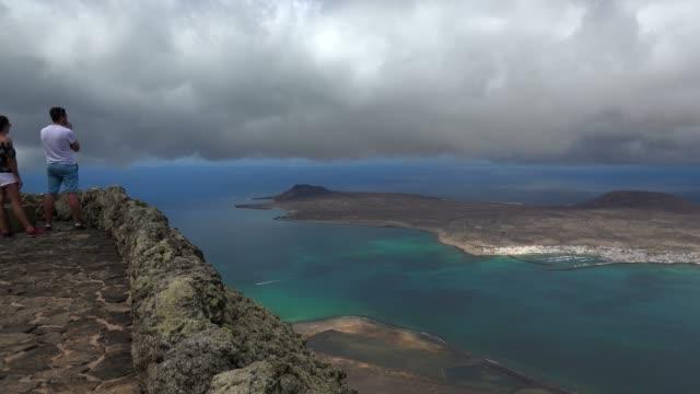 view from mirador del rio to la graciosa, lanzarote, canary islands, spain, atlantic, europe - atlantic islands stock videos & royalty-free footage