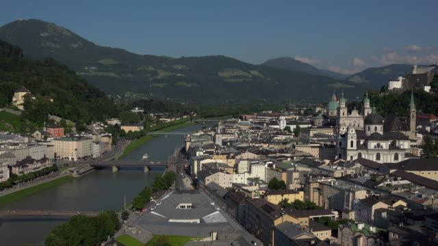 view from moenchsberg hill across river salzach with cathedral, collegiate church and fortress hohensalzburg, salzburg, austria - tornspira bildbanksvideor och videomaterial från bakom kulisserna