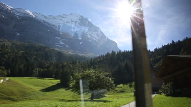 View from moving train below Eiger N face,  Jungfrau