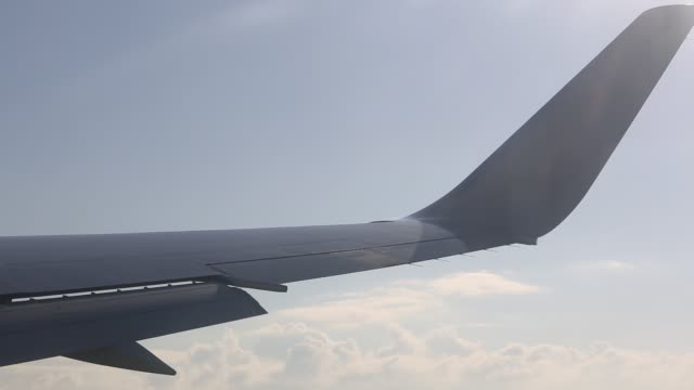 view from onboard the plane through the window of the plane's wing as it takes off from manchester airport, united kingdom on october 13, 2015. - speed stock videos & royalty-free footage