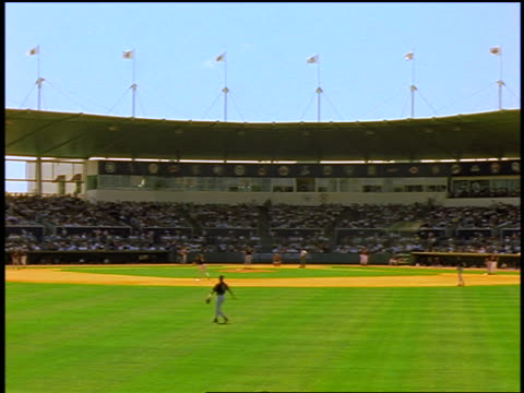 view from outfield of baseball stadium with time lapse crowd / fort myers, florida / spring training - spring training stock videos & royalty-free footage