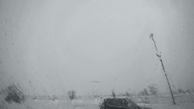 view from parked car to the highway under the snowfall - syracuse stock videos & royalty-free footage
