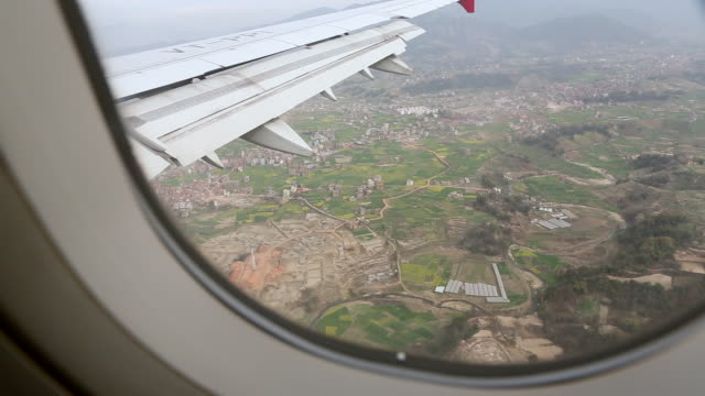 view from plane window of city audio / kathmandu, bagmati, nepal - kathmandu stock videos & royalty-free footage