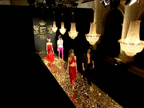 HA WS view from rafters of models in runway show/ TD pan male and female models walking up and down runway at B&C European Style fashion show/ Belgrade, Serbia