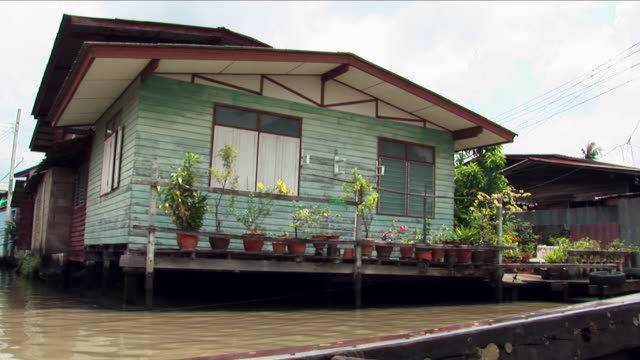 view from river boat in thailand - capanna video stock e b–roll