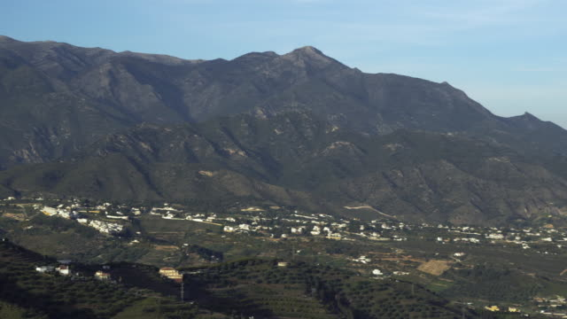 ws pan view from sierra de almijara mountains to seaside town of nerja / nerja, andalusia, malaga, spain - 2k resolution stock videos and b-roll footage
