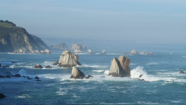 stockvideo's en b-roll-footage met view from silencio beach (playa del silencio) to rocks in water. - noord atlantische oceaan