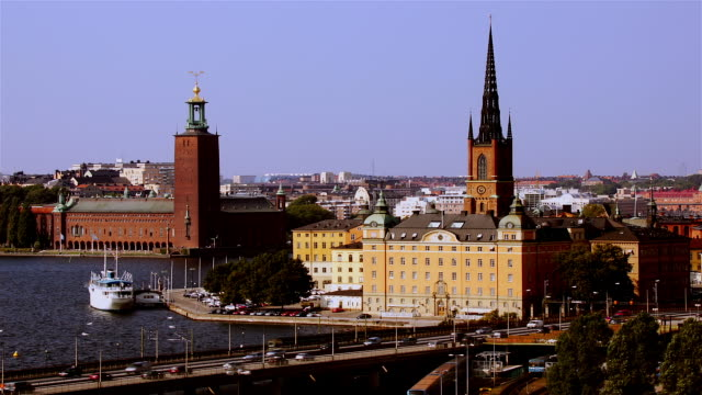 view from sodermalm of stockholm city hall and church of riddarholmen with traffic passing over bridge in fast motion / stockholm, sweden - famous place stock videos & royalty-free footage