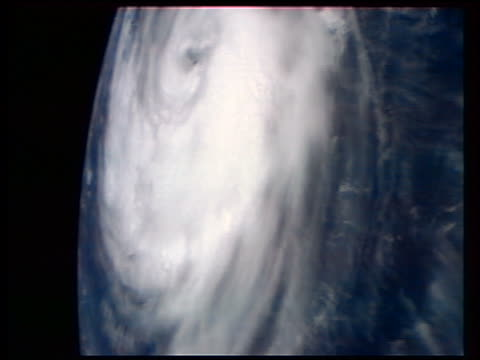 view from space of swirling storm clouds of hurricane delores - storm cloud stock videos & royalty-free footage