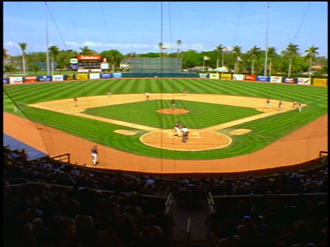 view from stands behind home plate of baseball stadium with time lapse crowd / fort myers, florida - fort myers stock videos & royalty-free footage