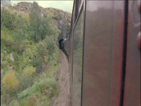 stockvideo's en b-roll-footage met view from steam train as it enters tunnel scottish highlands - schotse hooglanden