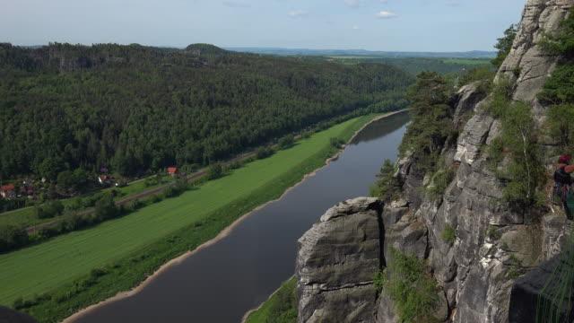vídeos de stock, filmes e b-roll de view from the bastei near rathen down into elbe valley, saxon switzerland, saxony, germany - corda de escalada