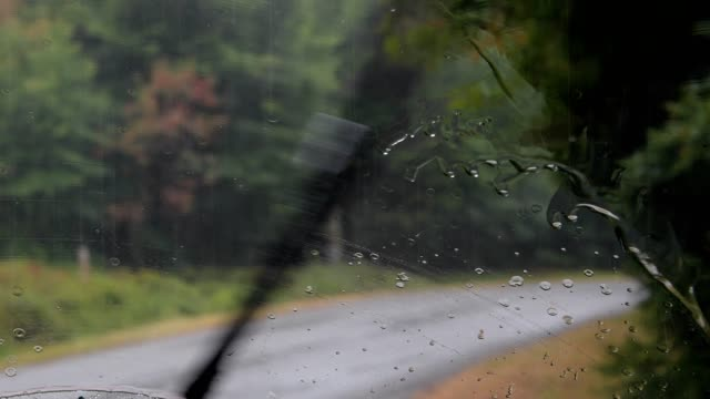 view from the car on the road in the rain - windscreen stock videos & royalty-free footage