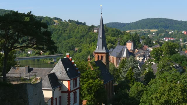 view from the castle ruins towards the protestant church and parish church of st. lawrence, saarburg, saar valley, germany - saarburg stock-videos und b-roll-filmmaterial