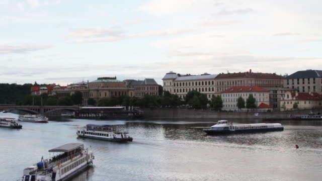 view from the charles bridge showing boats on the vltava river. - charles bridge stock-videos und b-roll-filmmaterial