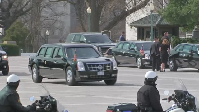 View from the East front as President Donald Trump and First Lady Melania Trump arrive at the Capitol building in a limousine for a memorial service...