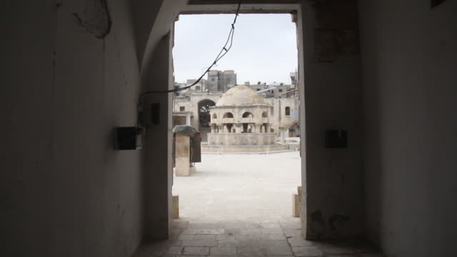 view from the entrance of the ablutions fountain of the 12th century ayyubid-era great mosque of maarat al-numan. the mosque was badly damaged during... - circa 12th century stock videos & royalty-free footage