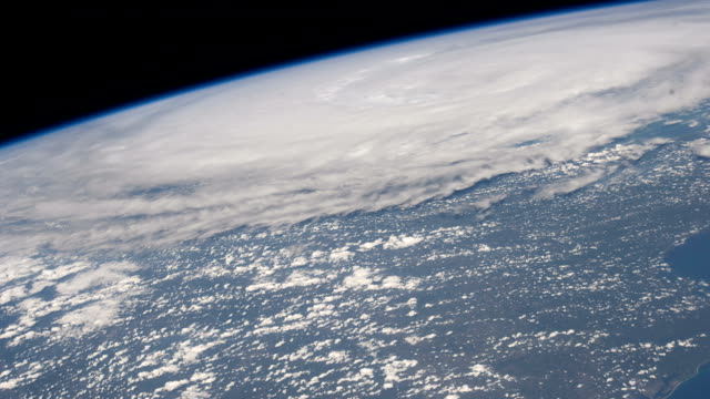 / view from the international space station of hurricane irene, a category 1 storm at the time, making landfall onto the coast of north carolina.... - hurricane irene stock videos & royalty-free footage