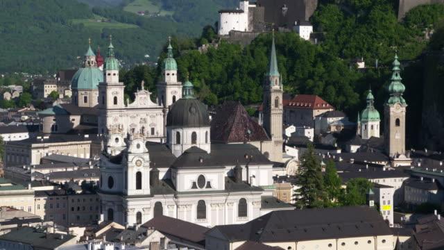 view from the mönchsberg terrace to salzburg cathedral and old town area of salzburg. salzburg, austria. - österrikisk kultur bildbanksvideor och videomaterial från bakom kulisserna