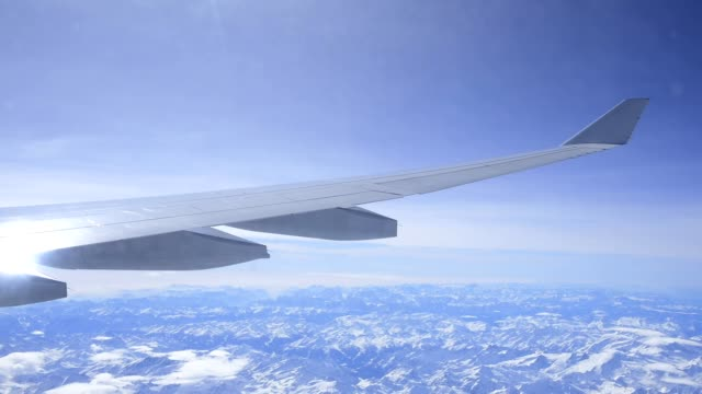 view from the plane on the wing during flight over the european alps - airbus stock-videos und b-roll-filmmaterial