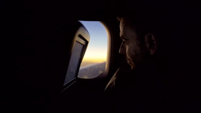 view from the plane window - in silhouette stock videos & royalty-free footage