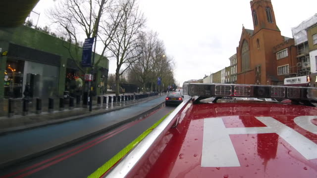 view from the roof of a paramedic's car as it drives through london - siren stock videos & royalty-free footage