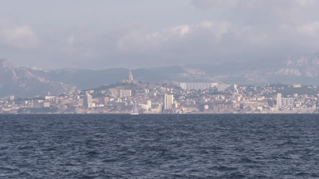 view from the sea - skyline marseille - notre dame de la garde marseille stock videos and b-roll footage