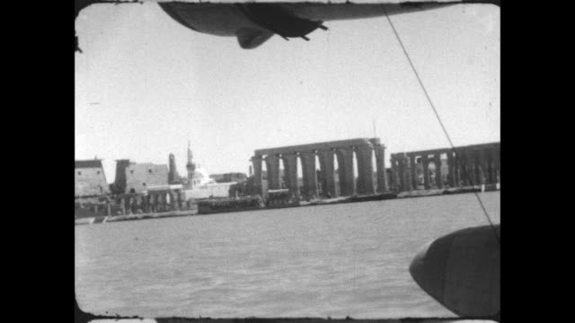 view from the short empire 'c' class flying boat a it begins its takeoff from the nile, passing by the temple of luxor. - british culture stock videos & royalty-free footage
