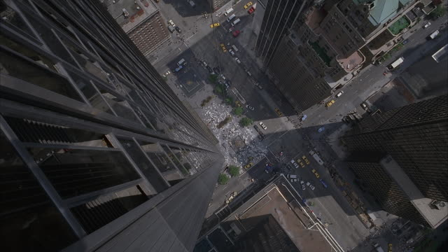A view from the side of a skyscraper giving the sensation of falling as the camera drops straight down.