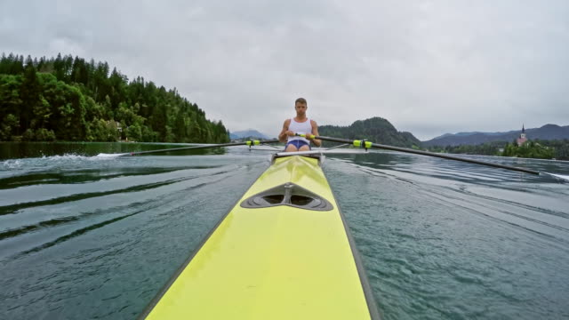 pov view from the stern of a male athlete rowing - oar stock videos & royalty-free footage