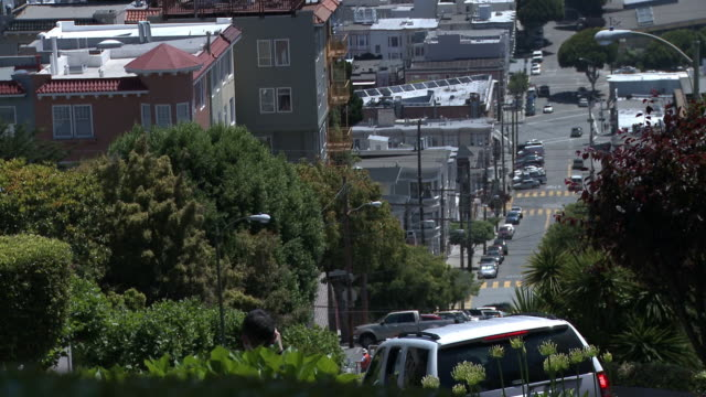 view from the top of lombard street in san francisco looking down the road. - lombard street san francisco stock videos & royalty-free footage