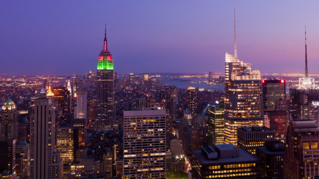 WS T/L View from the Top of the Rockefeller Center on Manhattan skyline from day to night / New York City, New York, USA