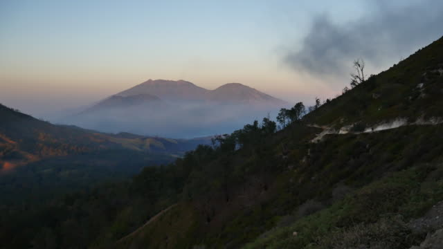 View from the tropical forest with path to the volcano Kawah Ijen, East Java, Indoneisa